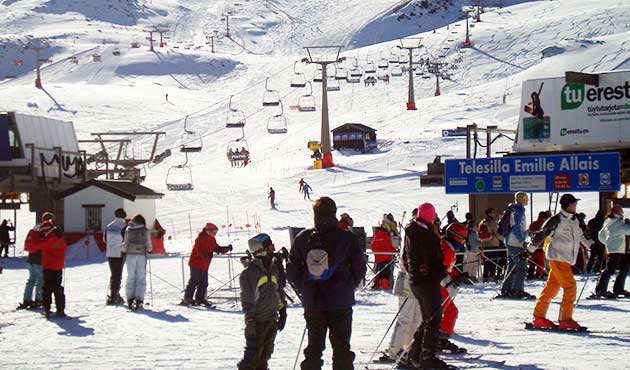 Snow and ski lifts at Sierra Nevada ski resort Spain